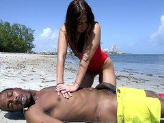 Lifeguard Valerie Kay revives Charlie by sucking his black piston